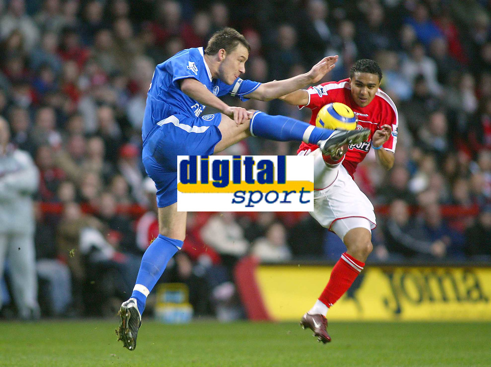 27/11/2004 - FA Barclaycard Premiership - Charlton Athletic v Chelsea - The Valley<br />Charlton Athletic's Jerome Thomas and Chelsea's John Terry both leap for the high ball.<br />Photo:Jed Leicester/Back Page Images