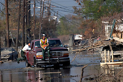 30 Sept, 2005. New Orleans, Louisiana. Lower 9th ward. Hurricane Katrina aftermath.<br /> The remnants of the lives of ordinary folks, now covered in mud as the flood waters remain. Members of the Humane Society ride through the floods in search of animals left behind when the storm hit.<br /> Photo; ©Charlie Varley/varleypix.com