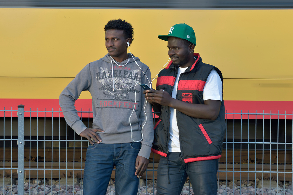 Russom Mahari (left), 26, an asylum seeker from Eritrea, and Baboucarr Ellsay, 20, an asylum seeker from Gambia, live in a church-run shelter in Freudenstadt, Germany. The Freundesdreis Asyl is run by Christlicher Kirchen, and managed by a retired United Methodist pastor. The shelter has 18 asylum seekers from Eritrea and 10 from Gambia. They came to Europe via Sudan and Libya, crossing the Mediterranean to Italy.