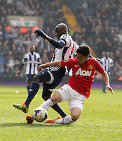 Manchester United's Shinji Kagawa (right) and West Bromwich Albion's Yousuff Mulumbu (left) in action