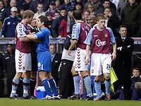 Fotball<br /> Premier League 2004/05<br /> Aston Villa v Birmingham<br /> Villa Park<br /> 12. desember 2004<br /> Foto: Digitalsport<br /> NORWAY ONLY<br /> Tempers flare in the Birmingham derby as Villa's Olof Mellberg (L) squares up to David Dunn