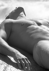 nude man soaking up the sun