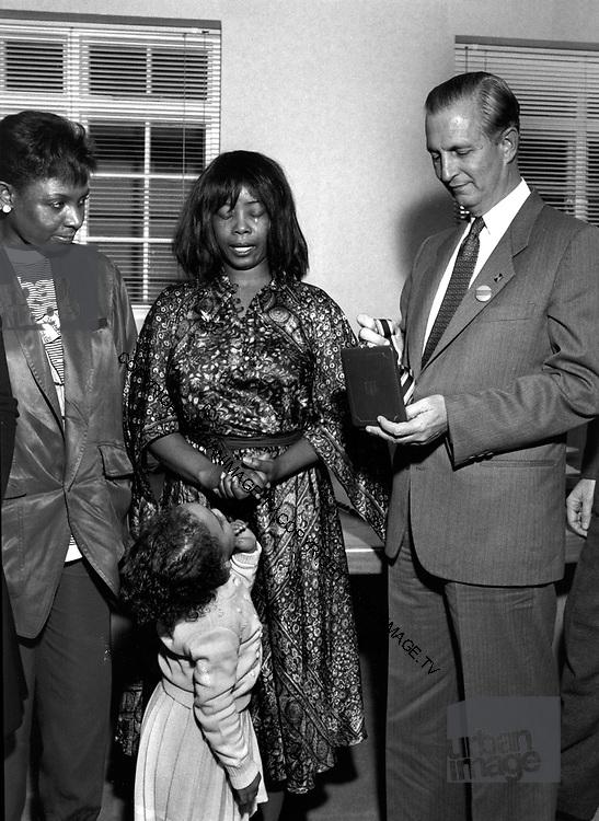 Edward Seaga with Millie Small at Island Records - 1980. Millie cries as Seaga awards a lifetime achievement award.