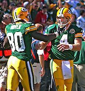 Green Bay Packers' Brett Favre and Donald Driver after Favre threw an 57-yard touchdown pass to Greg Jennings to give the Packers the lead late in the 4th quarter.  This touchdown was Favre's 420th touchdown tying Dan Marino for the NFL touchdown record. .The Green Bay Packers hosted the San Diego Chargers at Lambeau Field in Green Bay Sunday September 23, 2007. Steve Apps-State Journal.