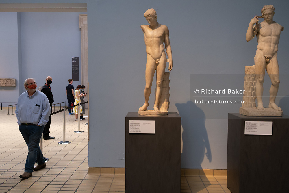 Now re-opened after months of closure during the Coronavirus pandemic, some of the first visitors who have pre-booked free tickets, once again enjoy the historical artifacts in the Greek and Roman room at the British Museum, on 2nd September 2020, in London, England.