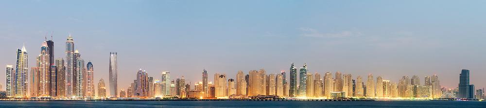 Evening panorama of Marina and Jumeirah Beach Residence (JBR) districts in Dubai United Arab Emirates