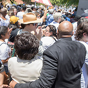 Democratic Congresswoman Maxine Waters is mobbed by supporters as she makes her way through the crowd to speak in Los Angeles at the Families Belong Together demonstration. Over 70,000 people took to downtown Los Angeles to protest against President Trump's immigration policies, in particular the policy to separate children from their parents at the border.