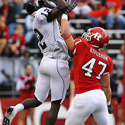 Sep 12, 2009; Piscataway, NJ, USA; Howard wide receiver Willie Carter (12) catches a touchdown pass over the reach of Rutgers cornerback Patrick Kivlehan (47) during the first half of Rutgers' 45-7 victory over Howard in NCAA College Football at Rutgers Stadium.