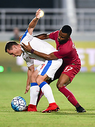 Jan Boril (L) of Czech Republic fight for the ball with Ismail Mohamad of Qatar during their International friendly soccer match at Al Duhail SC Stadium in Doha capital of Qatar, on November 11, 2017 . Czech Republic won 1-0  (Credit Image: © Nikku/Xinhua via ZUMA Wire)