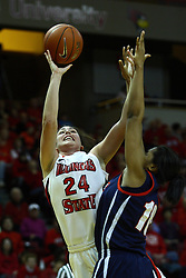 24 March 2011: Emily Hanley twists around Wumi Agunbiade for a shot during a WNIT (Women's National Invitational Tournament Women's basketball sweet 16 game between the Duquesne Dukes and the Illinois State Redbirds at Redbird Arena in Normal Illinois.