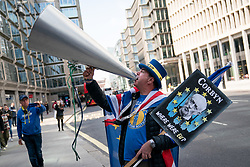 © Licensed to London News Pictures. 30/04/2019. London, UK. Anti-Brexit demonstrator Steve Bray outside Labour Party headquarters for a National Executive Meeting at which Labour's position on a second EU vote will be decided. Photo credit : Tom Nicholson/LNP