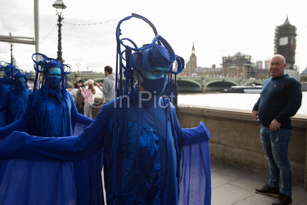 The blue rebels pass along the South Bank with fellow climate activists from the Ocean Rebellion and Extinction Rebellion during a colourful Marine Extinction March on 6 September 2020 in London, United Kingdom. The activists, who are attending a series of September Rebellion protests around the UK, are demanding environmental protections for the oceans and calling for an end to global governmental inaction to save the seas.