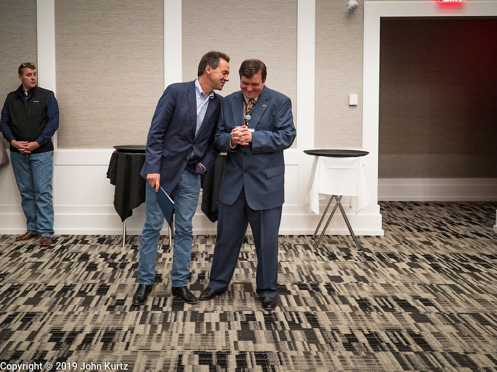 21 AUGUST 2019 - ALTOONA, IOWA: Governor STEVE BULLOCK (D-MT), left, and CHARLIE WISHMAN, the Iowa Federation of Labor Secretary Treasurer, chat before Bullock addresses union members. Many of the Democratic presidential candidates are addressing the Iowa Federation of Labor convention at the Prairie Meadow Casino in Altoona. They are hoping to secure labor support before the Iowa Caucuses on Feb. 3, 2020.      PHOTO BY JACK KURTZ