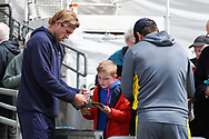 David Willey of Yorkshire signs an autograph for a young fan ahead of the opening day of the Specsavers County Champ Div 1 match between Yorkshire County Cricket Club and Hampshire County Cricket Club at Headingley Stadium, Headingley, United Kingdom on 27 May 2019.
