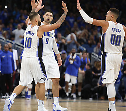 October 18, 2017 - Orlando, FL, USA - The Orlando Magic's Evan Fournier (10), Nikola Vucevic (9), and Aaron Gordon (00) celebrate amid a 116-109 win against the Miami Heat at the Amway Center in Orlando, Fla., on Wednesday, Oct. 18, 2017. (Credit Image: © Stephen M. Dowell/TNS via ZUMA Wire)