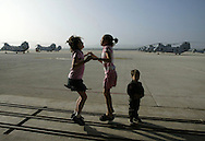 Caitlin Timney, 11, left, and Rachel Foy,12 can't contain their excitement while waiting for their fathers' Helicopter Squadron to return to Camp Pendleton Wednesday March 9, 2005 after seven months in Iraq.
