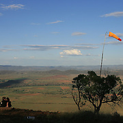 149 of the World's best paragliding pilots from 39 nations descended on the small country town of Manilla near Tamworth in northern New South Wales, Australia to contest the 10th FAI Paragliding World Championships during March 2007. The drought stricken area is renowned for it's great cross country flying from the Mount Borah hillside and over two hectic weeks, numerous incidents and mixed weather, the pilots were able to fly five tasks to decide the winners in what proved to be an extremely close contest.. The Men's competition was won by Great British pilot Bruce Goldsmith with Jean-Marc Caron of France finishing second just seventeen points behind with Thomas Mccune of USA finishing third. The women's competition was won by Petra Slivova of Czech Republic with Viv Williams of Australian just fifteen points behind and New Zealand pilot Harmony Gaw finishing third. .In the team event Czech Republic finished first followed by France and Switzerland....A couple kiss near the wind sock on to of Mount Borah after competition...