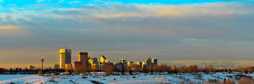Dramatic skies over the Calgary cityscape in the morning. Including the new Bow building towering over the buildings around it...©2010, Sean Phillips.http://www.RiverwoodPhotography.com