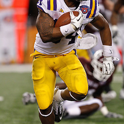 Jan 7, 2011; Arlington, TX, USA; LSU Tigers running back Stevan Ridley (34) against the Texas A&M Aggies during the fourth quarter of the 2011 Cotton Bowl at Cowboys Stadium. LSU defeated Texas A&M 41-24.  Mandatory Credit: Derick E. Hingle