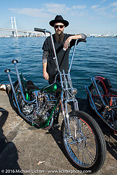 Ryan Grossman of Vintage Dreams with his rigid frame high bar Harley-Davidson Knucklehead at the Yokohama docks where the invited custom builder's bikes from the USA were unloaded prior to the Mooneyes Yokohama Hot Rod & Custom Show. Yokohama, Japan. December 3, 2016.  Photography ©2016 Michael Lichter.