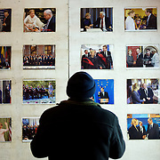 December 18, 2013 - Kiev, Ukraine: A man looks at a wall decorated with pictures of Ukraine's jailed former Prime Minister, Yulia Tymoshenko, near Independence Square.<br /> On the night of 21 November 2013, a wave of demonstrations and civil unrest began in Ukraine, when spontaneous protests erupted in the capital of Kiev as a response to the government's suspension of the preparations for signing an association and free trade agreement with the European Union. Anti-government protesters occupied Independence Square, also known as Maidan, demanding the resignation of President Viktor Yanukovych and accusing him of refusing the planned trade and political pact with the EU in favor of closer ties with Russia.<br /> After a days of demonstrations, an increasing number of people joined the protests. As a responses to a police crackdown on November 30, half a million people took the square. The protests are ongoing despite a heavy police presence in the city, regular sub-zero temperatures, and snow. (Paulo Nunes dos Santos/Polaris)