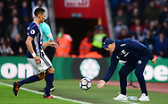 Tony Pulis, the manager of West Bromwich Albion throws the ball to Kieran Gibbs of West Bromwich .Premier league match, Southampton v West Bromwich Albion at the St. Mary's Stadium in Southampton, Hampshire, on Saturday 21st  October 2017.<br /> pic by Bradley Collyer, Andrew Orchard sports photography.