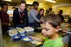 © Licensed to London News Pictures. 03/11/2014. LONDON, UK. The Deputy Prime Minister Nick Clegg, Lorraine Pascale and Lynne Featherstone serving lunch to school children at Weston Park Primary School in Crouch End, London on Monday 3 November 2014. Photo credit : Tolga Akmen/LNP