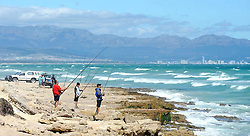 Cape Town - 111227 - A fairly strong wind was blowing when the Cape Argus team visited several Cape Town beaches. Pictured are people fishing near Monwabisi Beach. Reporter: Sibusiso Nkomo Photographer: David Ritchie