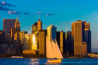 Sailboat with Lower Manhattan behind, New York, New York USA.