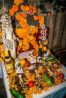 Altars for Night of the Dead (November 1), Noche de Muertos, Plaza Vasco de Quiroga, Patscuaro, Michoacan, Mexico. Traditions connected with the holiday include building private altars called ofrendas, honoring the deceased using calaveras, aztec marigolds, and the favorite foods and beverages of the departed, and visiting graves with these as gifts.