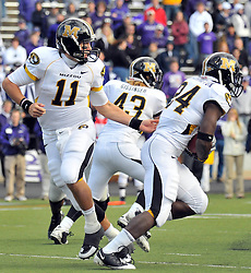Nov 14, 2009; Manhattan, KS, USA; Missouri Quarterback Blaine Gabbert (11) hands off to Missouri running back Derrick Washington (24) in the fourth quarter as the Tigers defeat the Kansas State Wildcats 38-12 at Bill Snyder Family Stadium. Mandatory Credit: Denny Medley-US PRESSWIRE