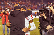 Ameer shakes hugs assistant coach Ron Brown after a 45-42 loss to USC at the Holiday Bowl in San Diego on Dec. 27, 2014, the final game of Abdullah's career. He rushed 27 times for 88 yards and a touchdown. He finished his career as Nebraska's all-time all-purpose yardage leader on 11th  on the NCAA charts with 7,168. © Aaron Babcock