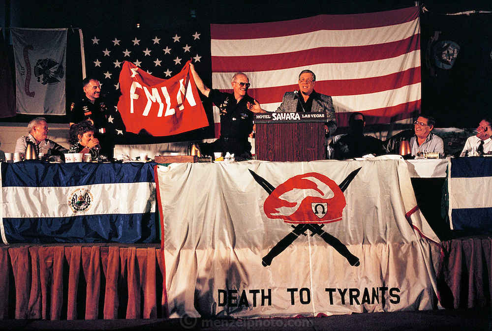Soldier of Fortune Convention, Las Vegas, Nevada, USA. Auction banquet of a captured FMLN flag from El Salvador.