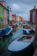 Canal and fishing boats on the Island of Burano near Venice Italy