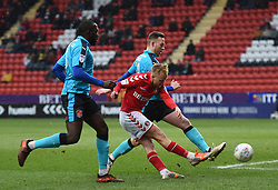 Charlton Athletic's Ben Reeves (centre) gets a shot away