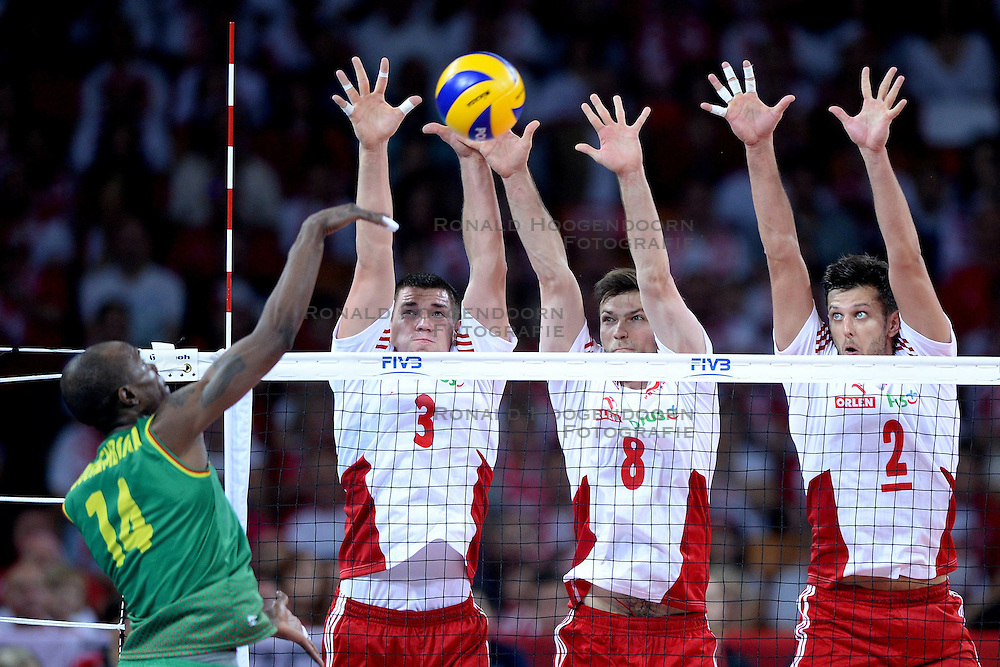 06.09.2014, Jahrhunderthalle, Breslau, POL, FIVB WM, Kamerun vs Polen, Gruppe A, im Bild NATHAN WOUNEMBAINA (L), DAWID KONARSKI (C), ANDRZEJ WRONA (C), MICHAL WINIARSKI (C), // during the FIVB Volleyball Men's World Championships Pool A Match beween Cameroon and Poland at the Jahrhunderthalle in Breslau, Poland on 2014/09/06. <br /> <br /> ***NETHERLANDS ONLY***