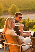Couple enjoys late afternoon wine tasting at Cuvaison, Napa, California