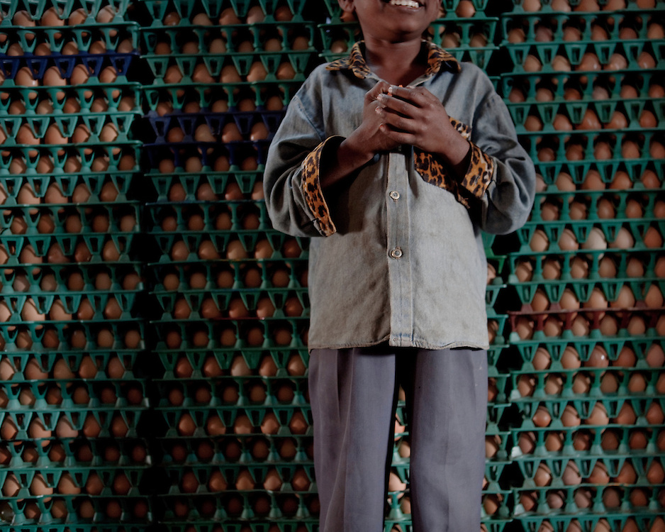 A boy in Asia selling Eggs
