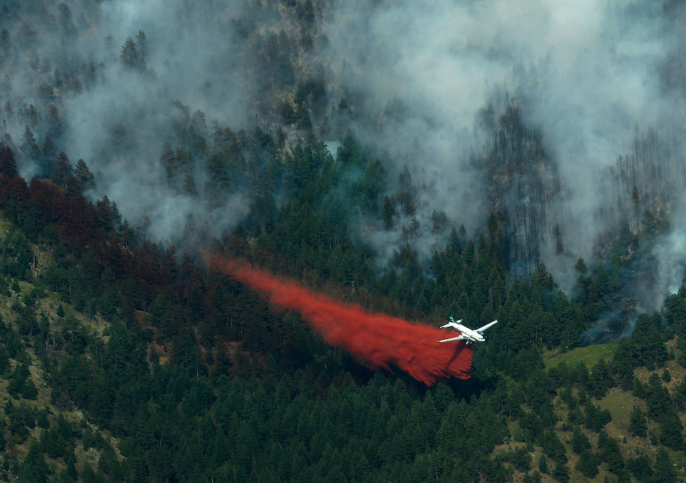 A slurry bomber tries to create a barrier to keep the wild fire from spreading, near Flagstaff Road and Bison Drive Tuesday, June 26, 2012 in the Walker Ranch area. The roughly 300 acre fire is visible from throughout Boulder County..(Matthew Jonas/Times-Call)