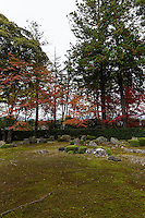 """Entsuji was originally a villa built in 1639 by emperor Go Mino. It was later converted to a temple, like many villas belonging to emperors, poets, writers, painters, daimyos and other important people.  Their purpose usually meant nice gardens and low rise buildings. <br /> The garden of Entsu-ji has a few unique points.  It is surrounded by hedge, though the garden is partially open and includes the surrounding landscape in its composition, particularly Mt Hiei which can be seen in the distance.  Several pine trees are growing along the hedge, splitting the """"borrowed"""" landscape of Mt Hiei and giving it a bit of extra texture.  The garden itself is covered in moss and groups of stones.  Flowering plants are also placed here and there, mostly rhododendrons."""