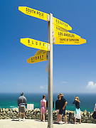 View of the signpost at Cape Reinga Lighthouse, furthest north point in New Zealand.