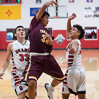 Tohatchi Cougar Bryan Chee (center) throws a pass to a teammate when he's pressured by Jeffery Jaramillo (left) and Isaiah Johnson (right) two defenders for Grants Pirates, Tuesday Nov. 27, at Grants High School.