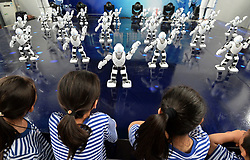 Aug. 18, 2017 - Handan, China - Robots dance as children look on during an exhibition in an amusement park in Handan City of north China's Hebei Province. Children on vacation are attracted to learn more about the machines. (Credit Image: © Hao Qunying/Xinhua via ZUMA Wire)