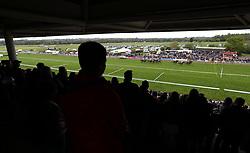 Spectators watch the Racing UK Profits Returned To Racing Handicap Hurdle