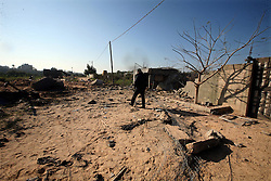 ©Licensed to London News Pictures. 29/12/2011, Gaza. .Palestinians survey an Islamic Jihad training camp damaged by an Israeli air strike in Gaza December 29, 2011. The Israeli army confirmed that it targeted two sites in Gaza, including the training camp, and added that the strikes were carried out in response to the firing of rockets from Gaza into Israel on Wednesday. No injures were reported in Gaza.. Photo Credit: Ali Jadallah /PNC/LNP