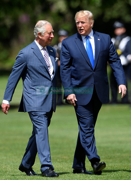 The Prince of Wales (left) meets US President Donald Trump as he arrives in Marine One at Buckingham Palace, in London on day one of his three day state visit to the UK.