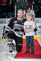KELOWNA, CANADA - DECEMBER 2: Rourke Chartier #14 of Kelowna Rockets accepts the first star of the game after scoring a hat trick against the Kootenay Ice on December 2, 2015 at Prospera Place in Kelowna, British Columbia, Canada.  (Photo by Marissa Baecker/Shoot the Breeze)  *** Local Caption *** Rourke Chartier;