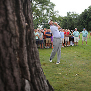 Matt Kuchar hits out of the rough on the first hole during the second round of theThe Barclays Golf Tournament at The Ridgewood Country Club, Paramus, New Jersey, USA. 22nd August 2014. Photo Tim Clayton