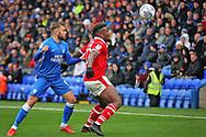 Barnsley defender Dimitri Cavare (12)  shields the ball from Peterborough United forward Matt Godden (9) during the EFL Sky Bet League 1 match between Peterborough United and Barnsley at The Abax Stadium, Peterborough, England on 6 October 2018.