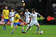 Swansea city's Alejandro Pozuelo ® makes a break. Barclays Premier league, Swansea city v Arsenal at the Liberty Stadium in Swansea on Saturday 28th Sept 2013.  pic by Andrew Orchard, Andrew Orchard sports photography.